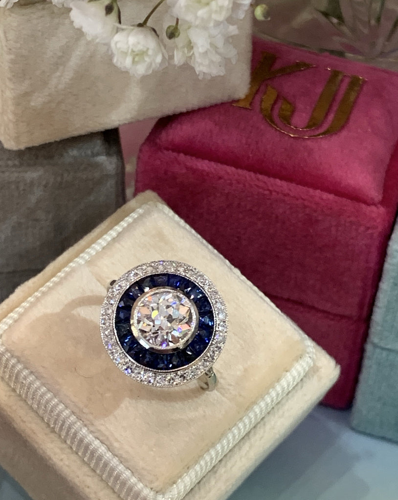 1.00 Carat Old Cut Diamond and Blue Sapphire Halo Target Ring in 18K Gold