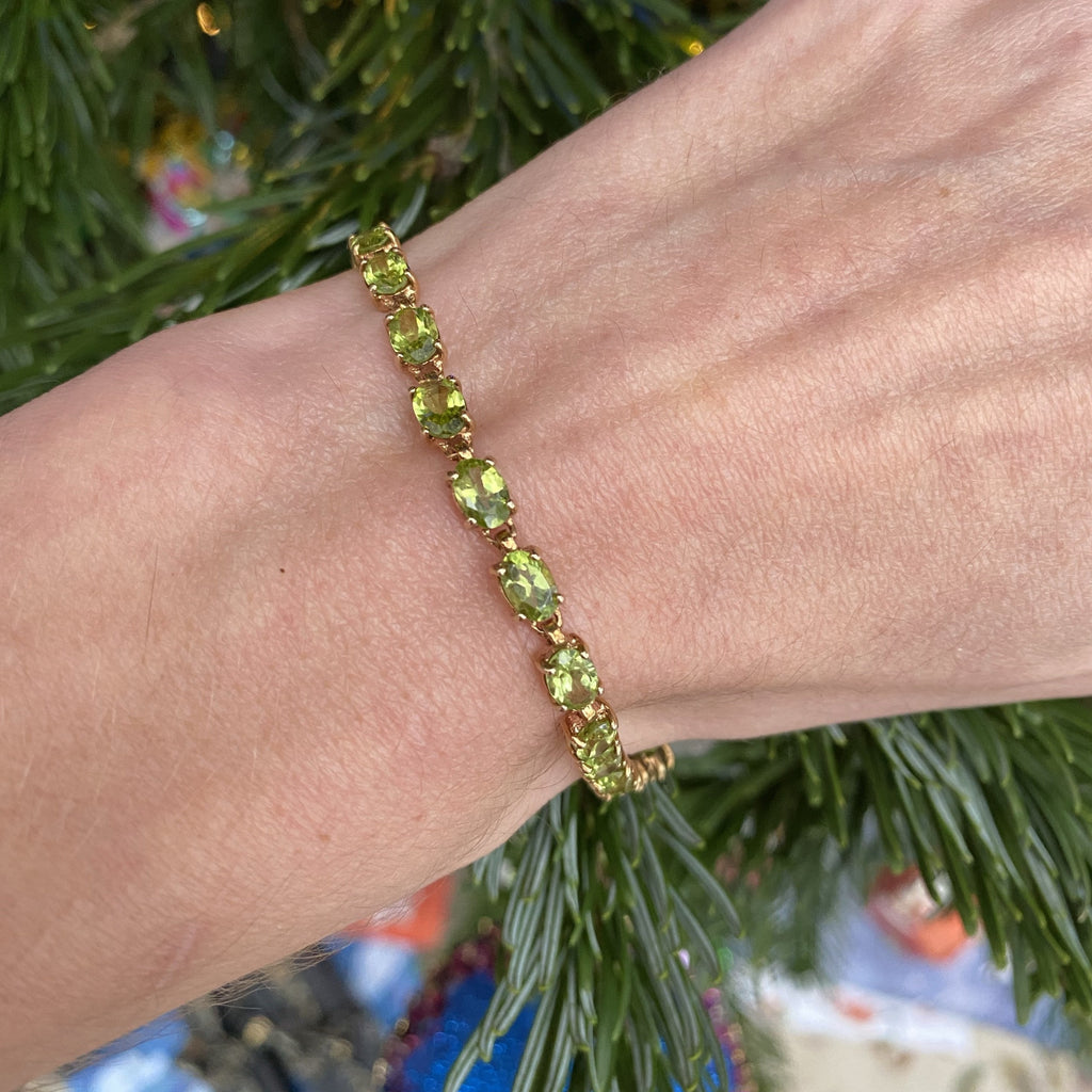 Sensational Peridot Line Bracelet in Yellow Gold