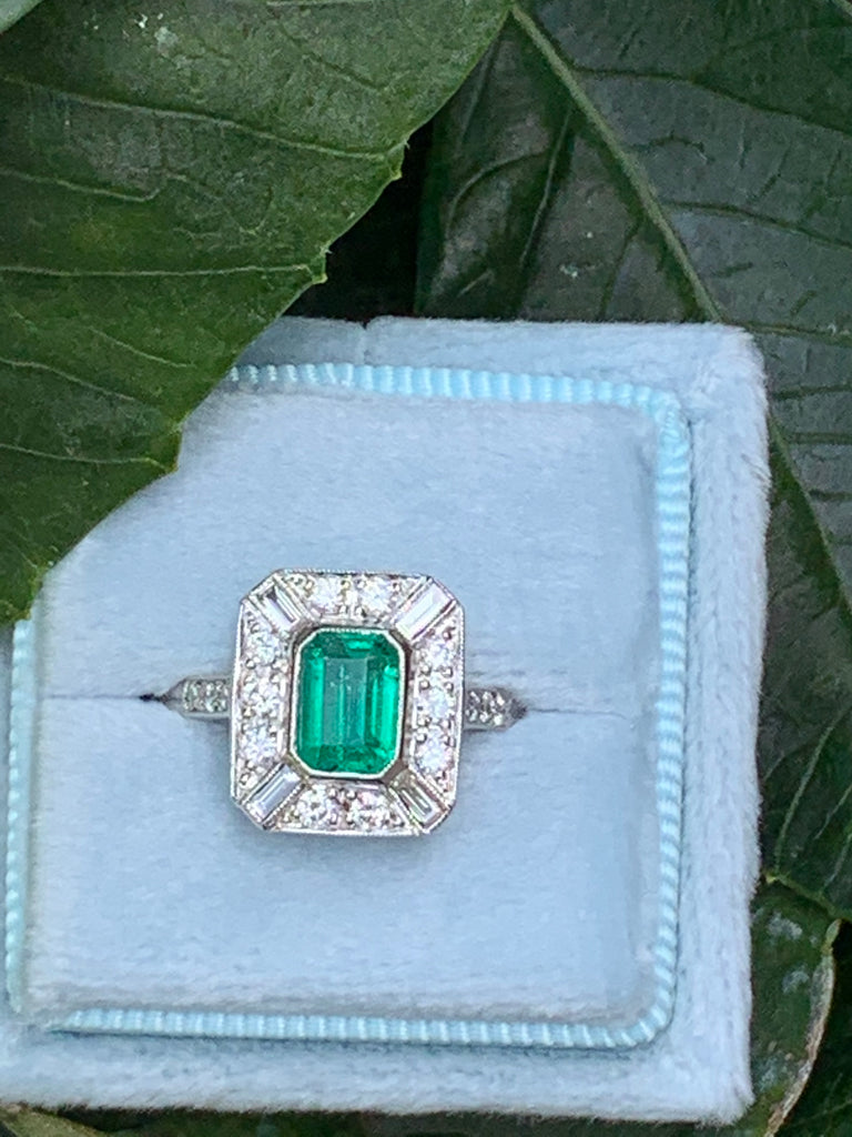 1.00 Carat Emerald and Diamond Halo Ring in Platinum