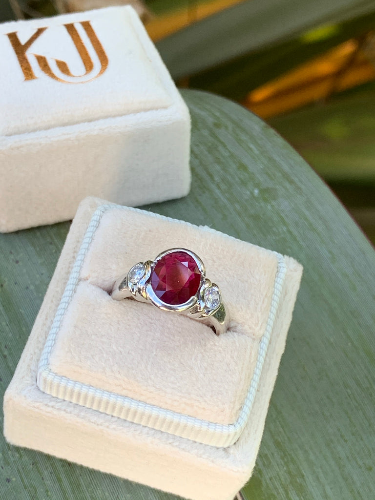 1.31 Carat Oval Ruby and Diamond Three Stone Ring in 18K White gold
