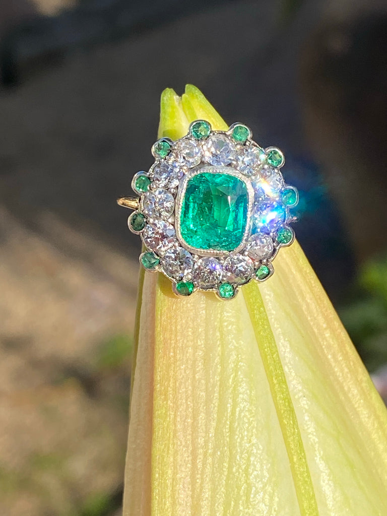 1.54 Carat Colombian Emerald and Diamond Halo Ring in 18ct Gold