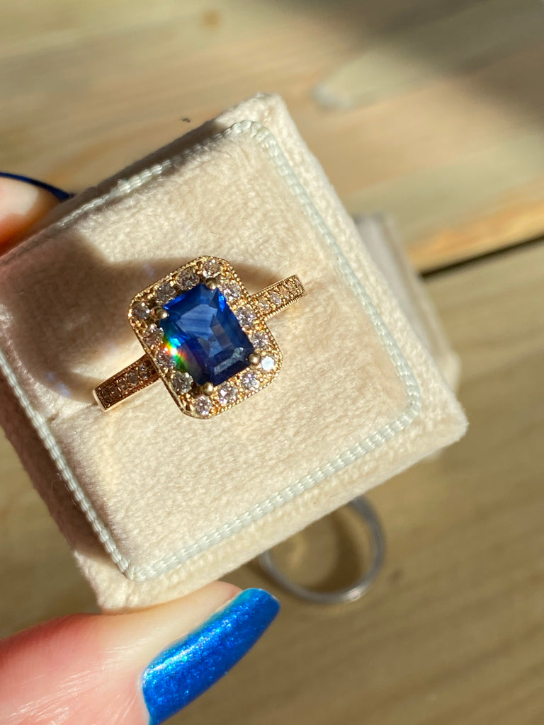 1.58 Carat Emerald Cut Blue Sapphire and Diamond Halo Ring in 18ct Yellow Gold