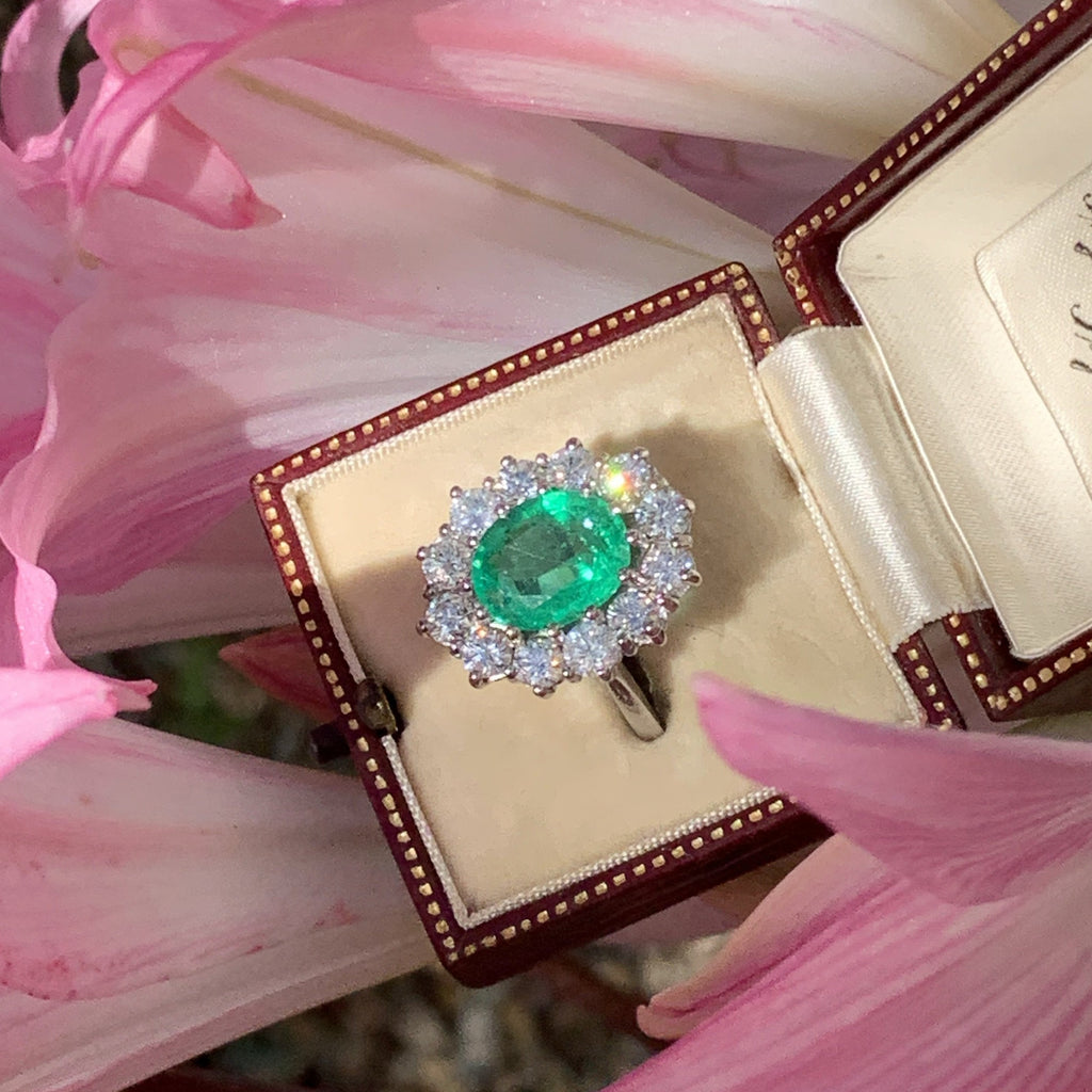 3.20 Carat Oval Emerald and Diamond Halo Ring in Platinum