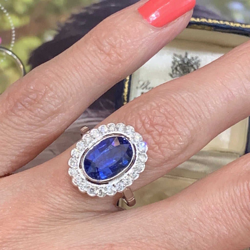 3.25 Carat Blue Sapphire and Diamond Halo Ring in Platinum