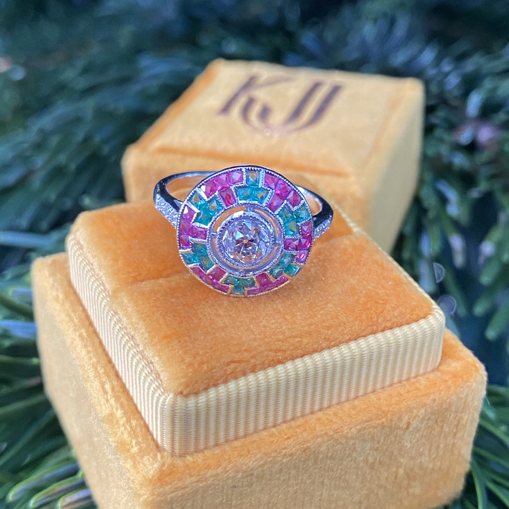Art Deco Diamond, Emerald and Ruby Halo Target Ring