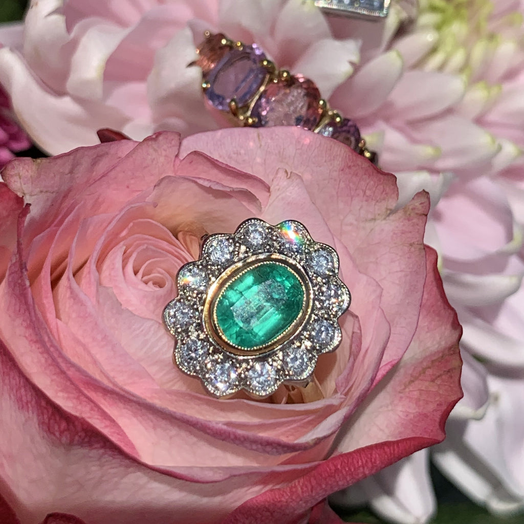 1.45 Emerald and Diamond Cluster Halo Ring in 18K Gold