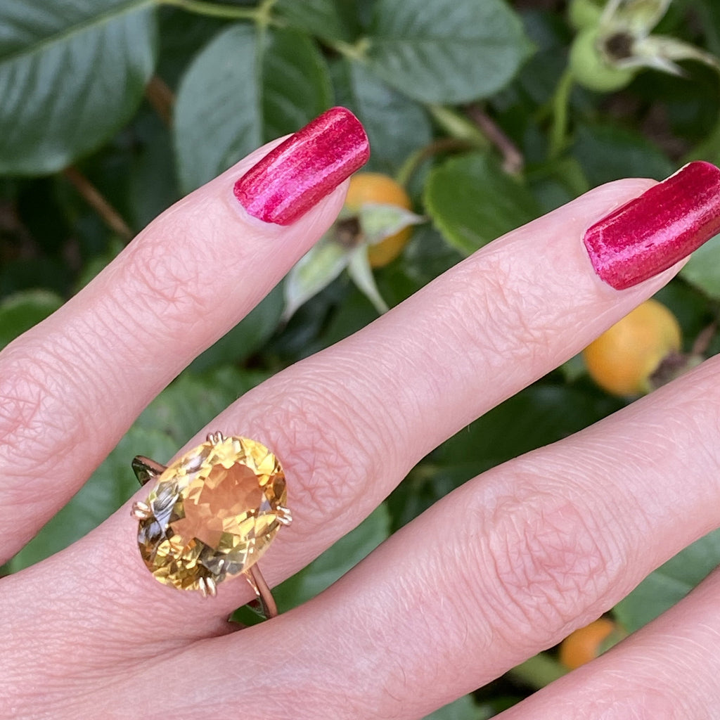 Oval Cut Citrine Ring in Yellow Gold
