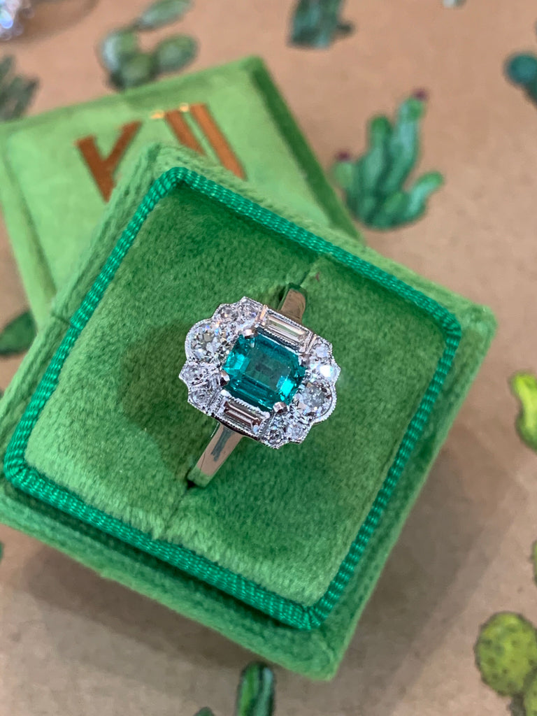 1.00 Carat Zambian Emerald and Diamond Halo Ring in Platinum