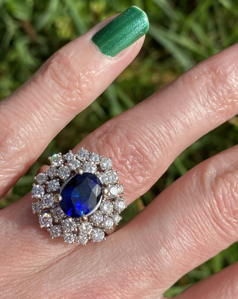 4.47 CTW Blue Sapphire and Diamond Halo Ring in 18ct White Gold