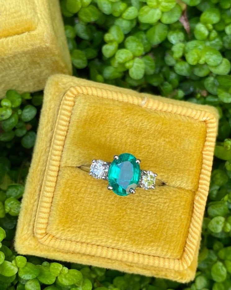 Breathtaking Emerald and Diamond Three Stone Ring