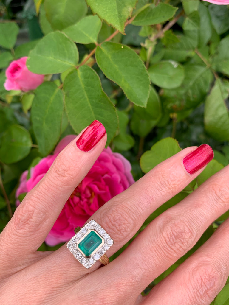 1.75 Carat Emerald and Diamond Halo Ring in 18K Gold