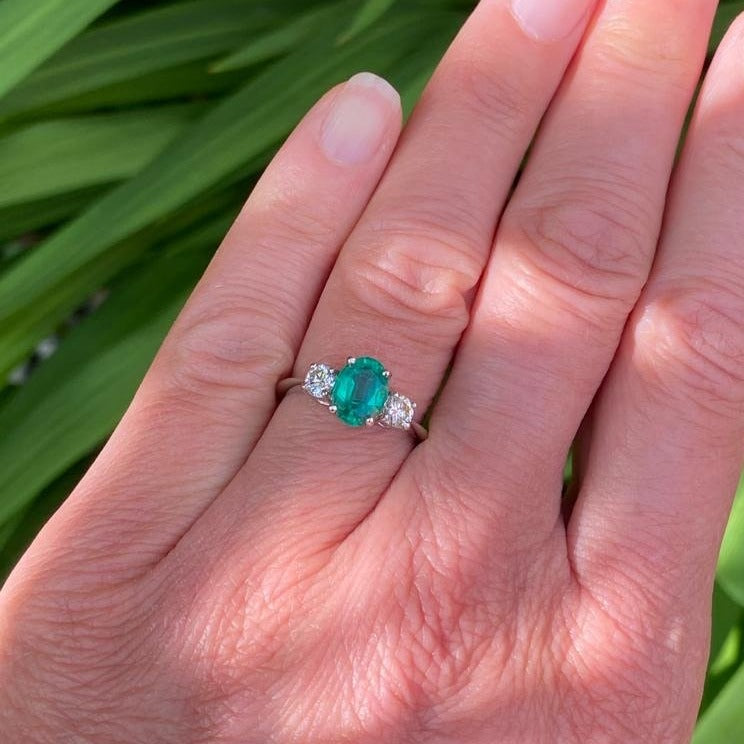 1.22 Carat Oval Emerald and Diamond Three Stone Ring in Platinum