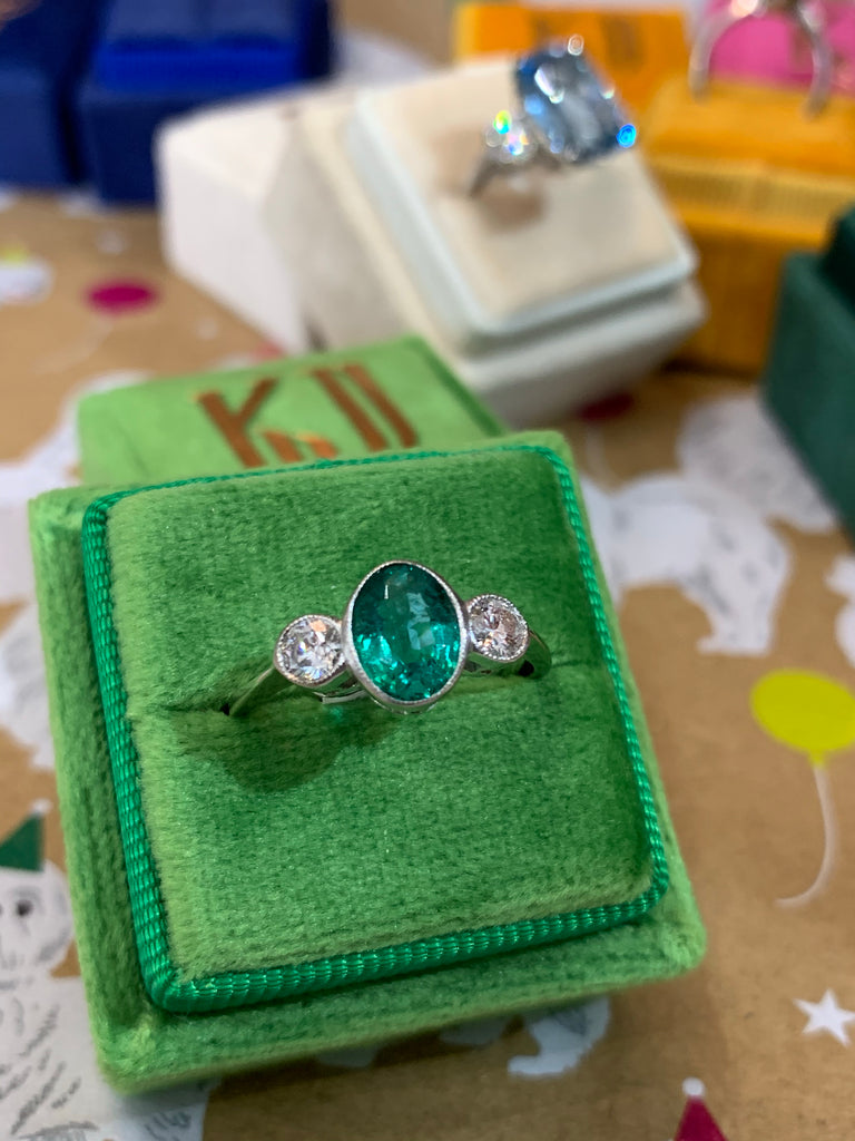 1.01 Carat Oval Emerald and Diamond Three Stone Ring in Platinum