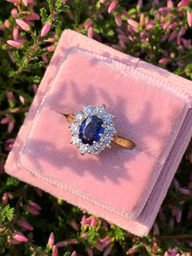 1.00 Carat Oval Blue Sapphire and Diamond Halo Ring in 18ct Gold