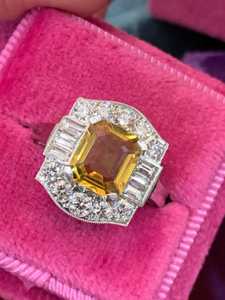 Yellow sapphire and diamond ring in platinum