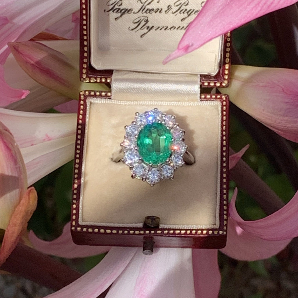 3.20 Carat Oval-Cut Emerald and Diamond Halo Ring in Platinum