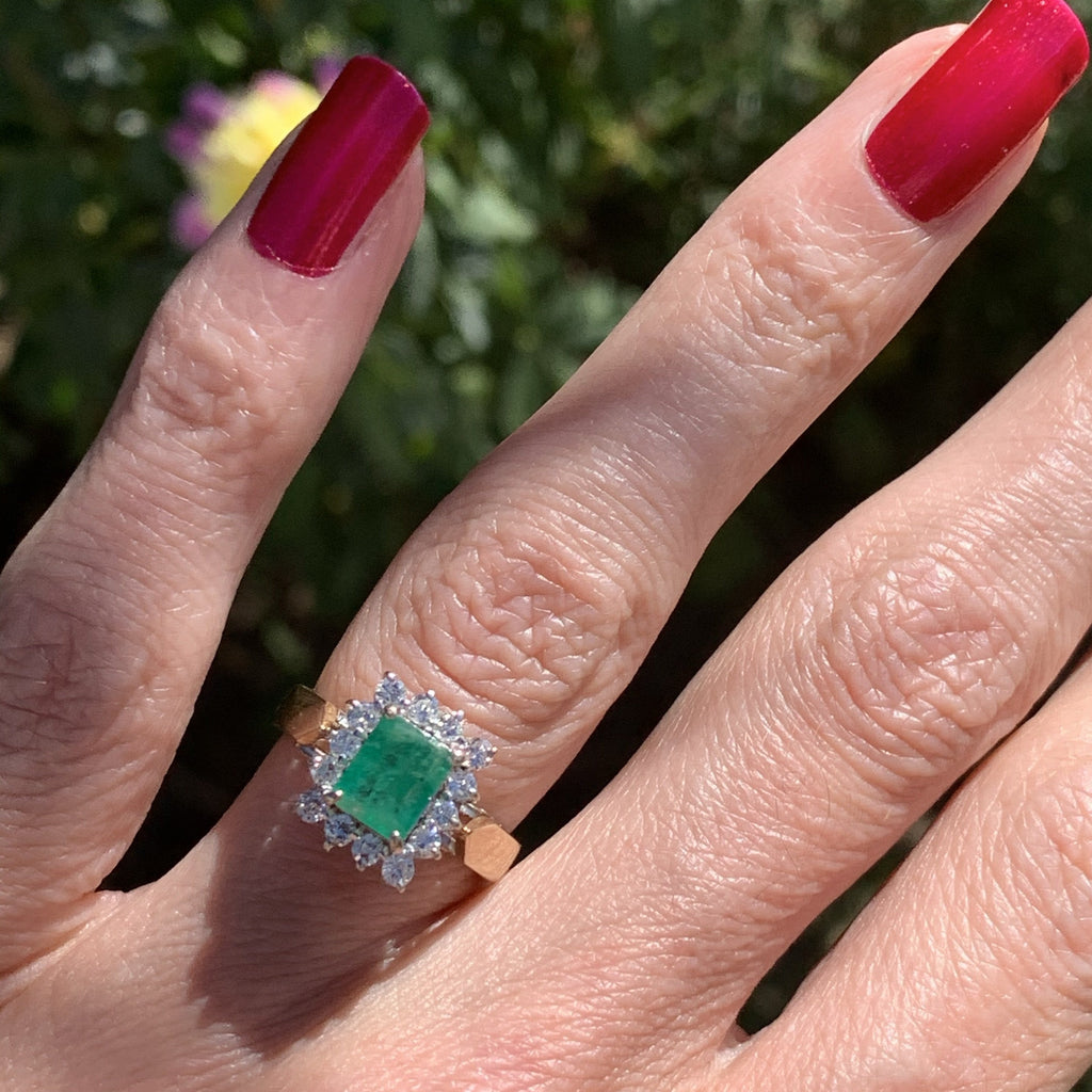 0.79 Carat Vintage Emerald and Diamond Halo Ring in 18K Gold
