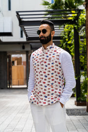 Made by saffron lane, modern indian men's clothing, Indo western men's clothing. Colorful elephant printed nehru vest with an ivory base. Perfect for Indian wedding celebrations, wear to a Mehndi or Sangeet party