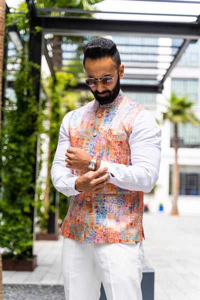 Made by Saffron Lane, modern Indian menswear, Indo western men's clothing. Multi-color printed linen-poly blend nehru vest. Perfect for Indian wedding celebrations, wear to a Mehndi or Sangeet party