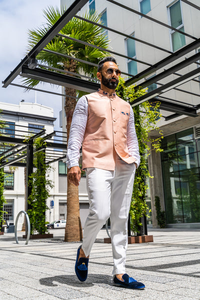 Made by Saffron Lane, modern Indian menswear, Indo western men's clothing. Peach silk blend nehru vest. Perfect for Indian wedding, Mehndi, or Sangeet party