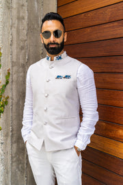 Made by Saffron Lane, modern Indian menswear, Indo western men's clothing. Light grey silk blend nehru vest. Perfect for Indian wedding, Mehndi, or Sangeet party