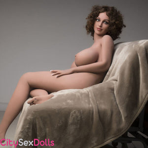 Boobilicious Sex Doll with Curly Hairs on sofa