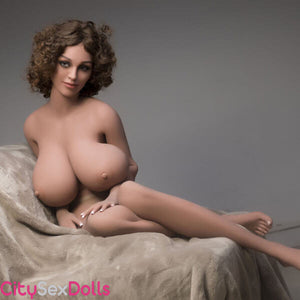Boobilicious Sex Doll with Curly Hairs showing her melons