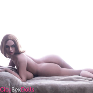 Huge Tits Blondie Sex Doll on bed baked