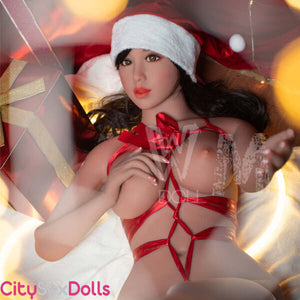 Santa Lovedoll with huge Melons getting naked