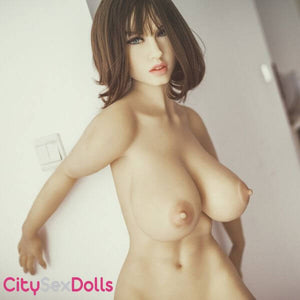 Sexy Stripper Love Doll showing her juicy boobs