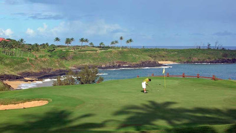 putting out on the 15th green at Kauai Lagoons