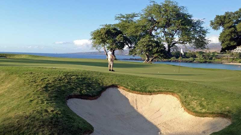 putting out on 11th hole at Mauna Kea Hawaii