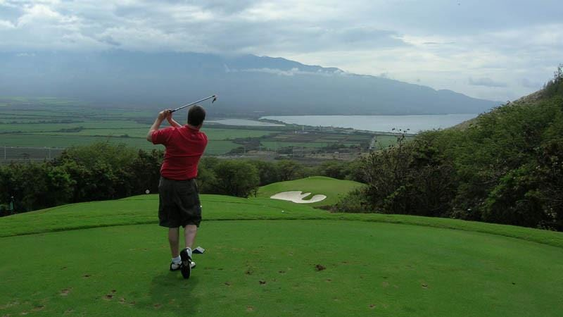Kahili Golf Course teeing off on par 3 12th hole with ocean view