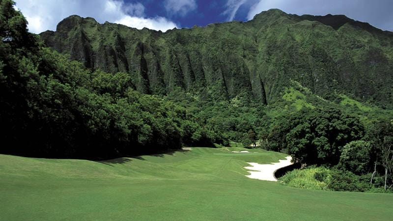 Ko'olau Golf course 3rd hole with the majestic mountains in rear