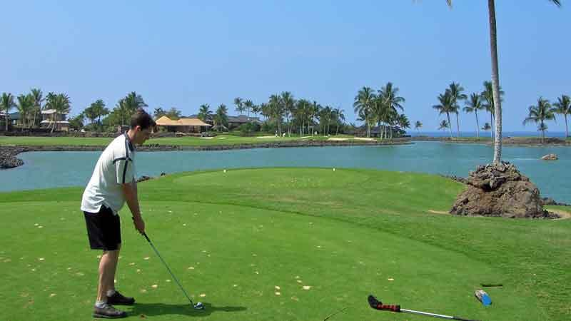 Teeing off on the 12th over the lake at Mauna Lani South