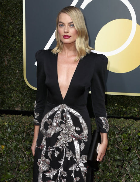 fc0d31e19ea Gucci rarely disappoints and is especially popular now. What was your  favorite look of the night  Margot Robbie s dress ...
