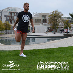 stretching infront of the Scottish Parliament wearing Cahoonas tartan baselayers