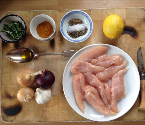 Flat lay ingredients for turmeric and rosemary chicken
