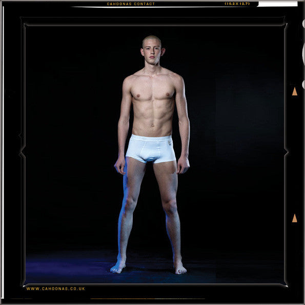 Paul Owen J Carrigan, wears the Cahoonas 75 trunk. The worlds only dress preference male underwear shown here in white warp knitted British microfibre