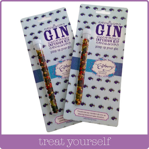 A pair of Edinberry Gin infusion kits which contain a selection of Gin botanicals in a test tube, red peppercorns, green cardamom pods, coriander seed, juniper berries, rose petals and hibiscus.