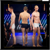The British Patented Cahoonas 75 trunk as being showcased by 3 models on the catwalk; including: top British male super model:- Paul Owen J Carrigan of Storm Models and tomorrow models