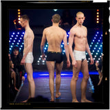 The British manufactured Cahoonas 75 trunk as being showcased by 3 models on the catwalk; including: top British male super model:- Paul Owen J Carrigan of Storm Models and tomorrow models