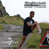 Stretching on Arthurs seat in Edinburgh while wearing the new Cahoonas black British Microfibre Baselayer