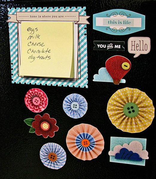 Magnetic sticky note holder and refrigerator magnets by Creative Team Member Camille Robinson