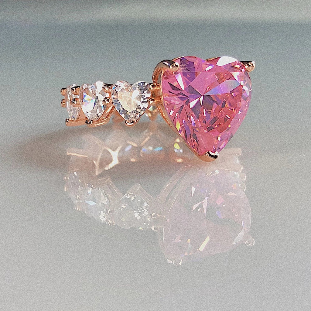 Made in New York City, Sterling Silver 8mm pink crystal heart diamond with cubic zirconia 4mm crystal hearts all around. Hypoallergenic.