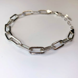 Made in New York City, our beautiful sterling silver paperclip bracelet embellished with cubic zirconia stones. Hypoallergenic. Available in gold & silver.