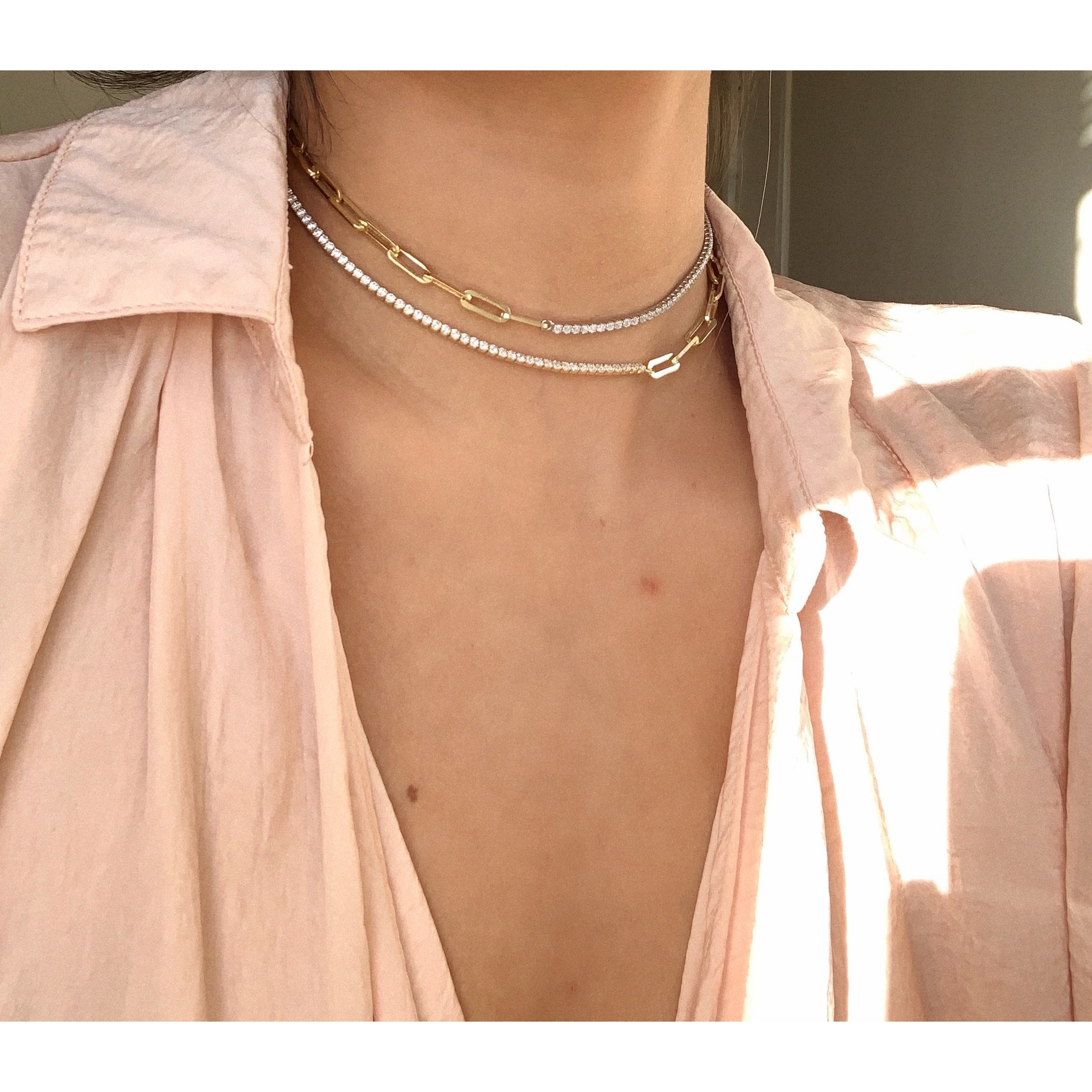 Made in New York City, our beautiful sterling silver paperclip necklace and a tennis necklace on the other side. Hypoallergenic. Available in gold & silver.
