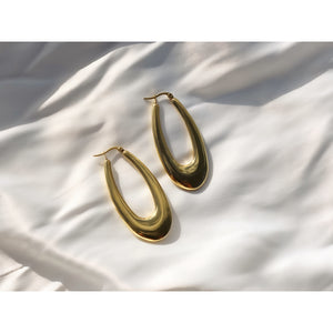 Made in New York City, oval hoops are stainless steel with 14k gold plating.