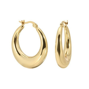 Made in New York City, these hoops are stainless steel with 14k gold plating.