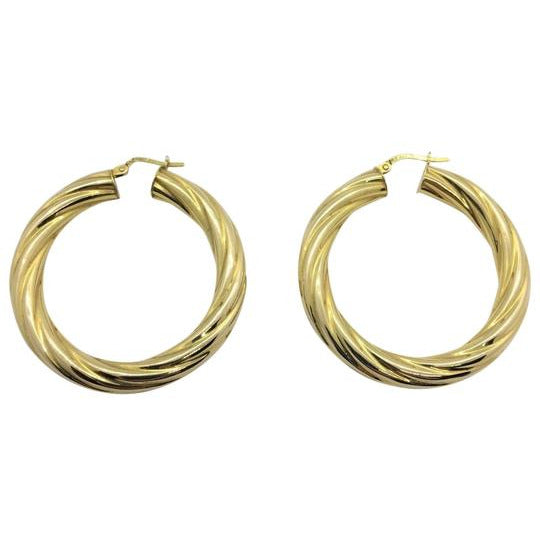 Made in New York City, our beautiful 18K gold plated bronze stainless steel hoops.